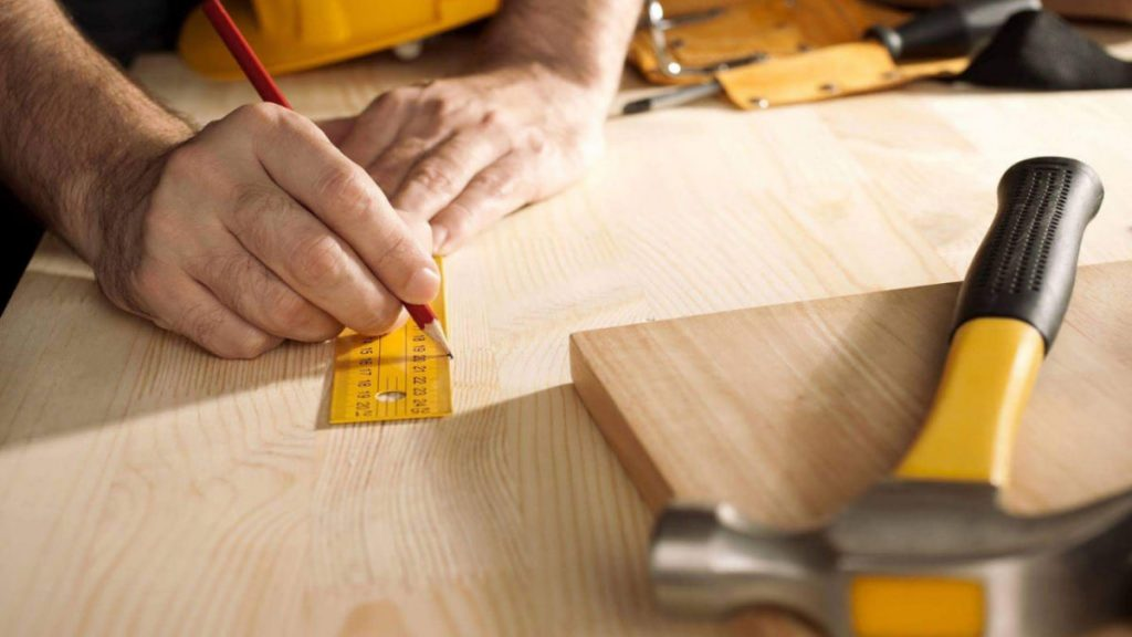 renovation-planning-measuring-working-with-hands-on-table
