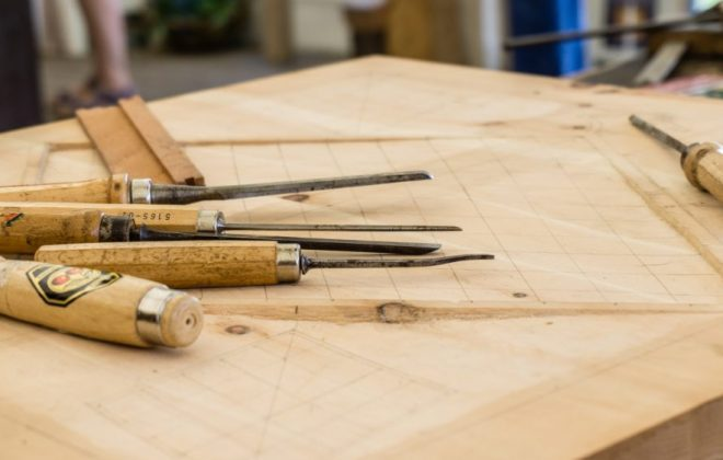 wood-carving-tools-laying-on-table